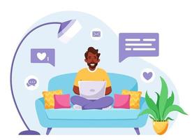 Black man sitting on a sofa and working on laptop. Freelancer, home office concept. Vector illustration