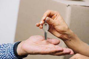 Cropped people's hands exchanging keys