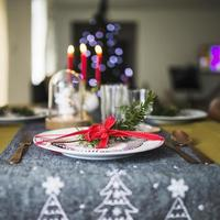 Decorated plate on Christmas tablecloth photo