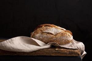 Delicious bread on towel photo