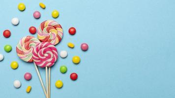 Delicious candy concept with copy space on blue background