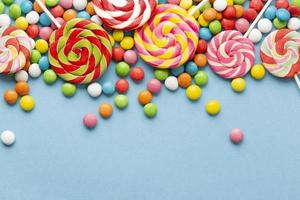 Delicious candy concept with copy space on light blue background