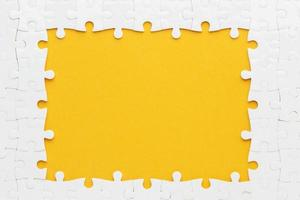 Flat lay puzzle frame concept with yellow and white colors photo