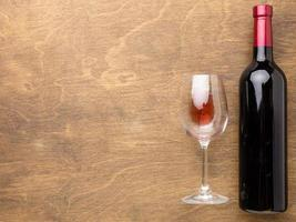 Flat lay wine bottle glass with copy space photo