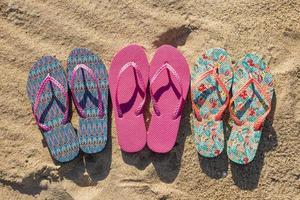 Flat lay of three pairs flip flops photo