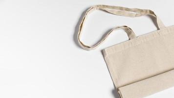 Folded fabric tote bag flat lay photo