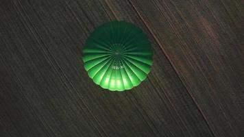Aerial Top Down View of a Hot Air Balloon on a Sunny Spring Evening video