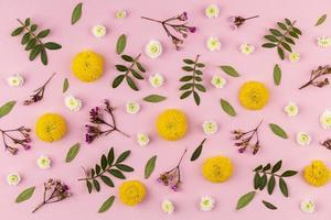 Flat lay flowers on pink background photo