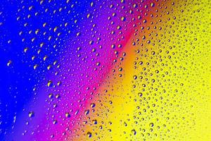 Rainbow background with rain drops