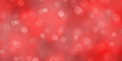 Light Orange vector background with spots.