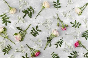 Flowers flat lay on grey background photo