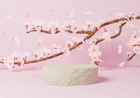 Roca para la presentación del producto con una rama llena de flores de cerezo, ilustración 3d foto