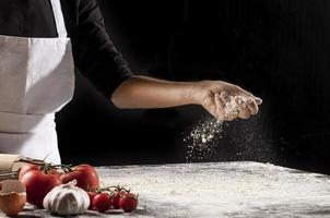 Close-up hand holding flour