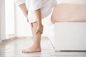 Close-up hands massaging legs photo