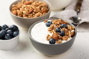 High angle breakfast cereal with blueberries and yogurt photo