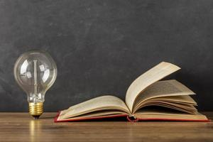 Composition with book light bulb photo