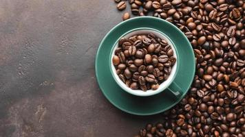 Cup filled with organic coffee beans on dark background photo