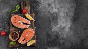 Delicious fresh salmon fish on dark gray background photo