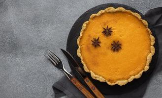Delicious pumpkin pie, top view photo