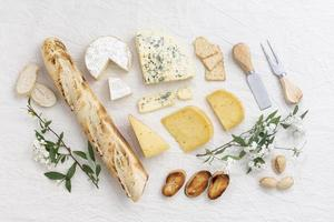 Delicious variety of snacks on white table, top view photo
