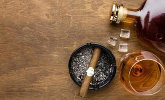 Flat lay cognac and cigar with copy space