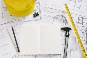 Helmet and drafting supplies blueprints photo
