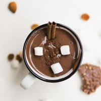 Hot chocolate with pretzel straws and marshmallows photo