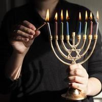 Jewish candlestick holder with candles photo