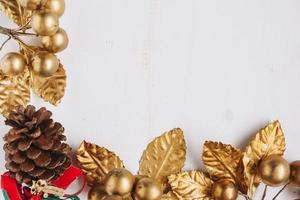 Christmas composition of gold berries border background photo