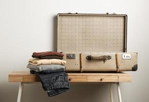 Close-up vintage suitcase with casual clothes photo