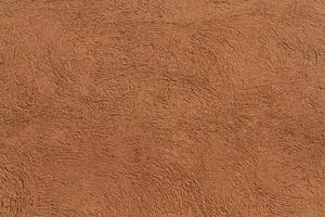 Copie el espacio de fondo de textura de pared de gamuza marrón foto