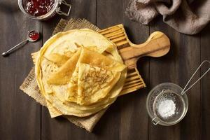 Delicious winter crepe dessert with jam and sugar photo