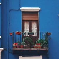 Window on the blue facade of the house, architecture in Bilbao city, Spain photo