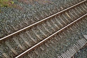 Railroad track in the station, train mode of transportation