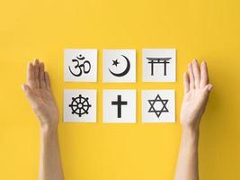 Flat lay of religious symbols on yellow background photo