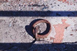 Old abandoned metallic chain photo