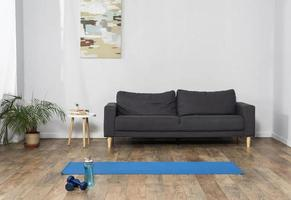 Front view of room interior with weights and water bottle, health concept