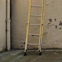Old ladder on the wall photo