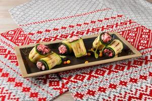 Grilled zucchini rolls with homemade cheese and dried beetroot photo
