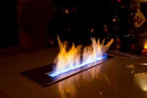 Modern bio fireplace on the marble slab