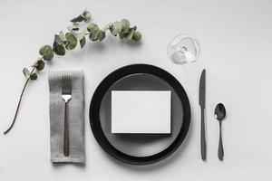 Table setting with plant top view photo