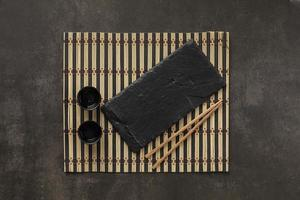 Table setting with cups and chopsticks photo