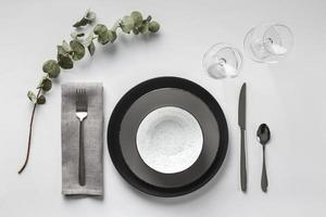 Table setting with eucalyptus branch photo