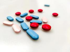 Colorful pills on the table photo