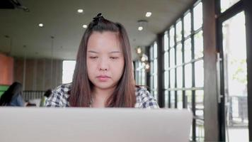 Freelancer Asian Woman Using Laptop Working in a Coffee Shop video
