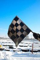 Old checkered flag in a winter race track photo