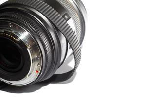 SLR photography lens with stretched rubber ring over time isolated on white background photo