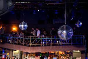 Blue disco background with mirror balls photo