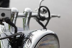 Close up of motorcycle headlight photo
