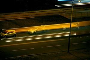 Night road with blurry traffic light trails, long exposure photo